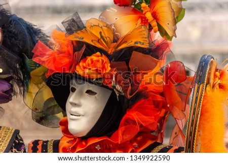 Italy, Venice, 2 March 2019, carnival, masked people go around in Piazza San Marco, in the streets and canals of the city, posing for photographers and tourists, with beautiful clothes. #1349922590