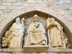 Italy, Volterra, a sculptural religious niche on the wall of the cathrdral