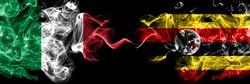 Italy vs Uganda, Ugandan smoky mystic flags placed side by side. Thick colored silky abstract smoke flags of Italian and Uganda, Ugandan