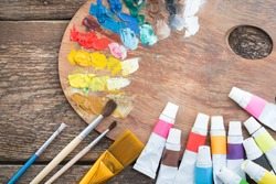 Items for children's creativity on a wooden background