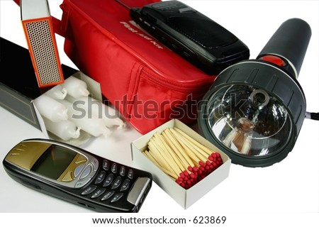 Items for emergency or power outage kit - mobile phone, candles, matches, torch, first aid, battery radio