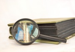 Items for philately - magnifier and album for stamps