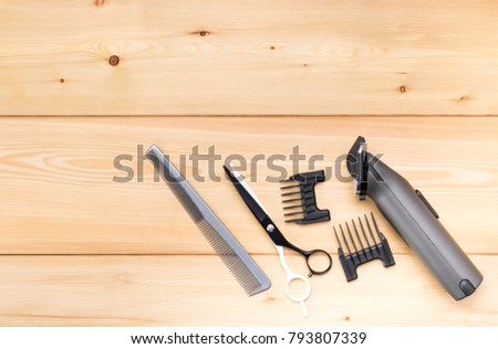 items for short hair cutting, on a wooden background