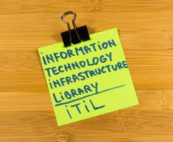 ITIL, Information technology infrastructure library sticky note on wooden background