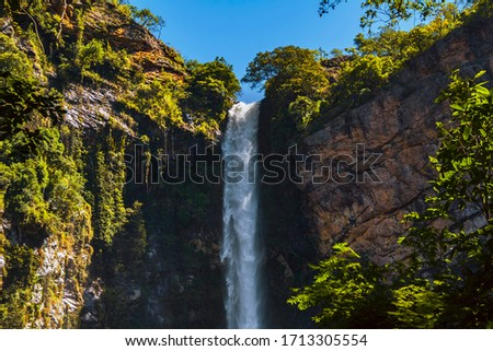 Itiquira waterfall, city of Formosa, state of Goias, Brazil. Salto Itiquira. Beautiful and paradisiac landscape. Preserved park in South America. Foto stock ©