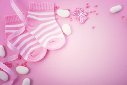 Its a Girl pink theme Baby Shower or Nursery background with decorated borders on pink wood background, with applied retro style filters.