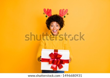Its for you! Santa helper giving package concept. Photo of pretty funny funky glad positive excited with toothy smile girl holding big white giftbox in hands isolated vivid color background