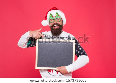 Its up to you. Santa school publicity. Happy hipster point finger at blank publicity board. New year and xmas advert. Marketing. Publicity and education. New year and Christmas publicity, copy space.