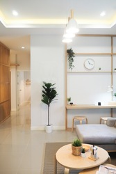 ivingroom area white and light wood tone interior house japanese style