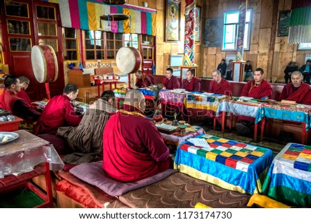 IVOLGINSKY DATSAN, ULAN UDE, SIBERIA, RUSSIA - MARCH 24, 2018: Buryat buddhist monks are praying at the Dzogchen Dugan in Ivolginsky datsan  #1173174730