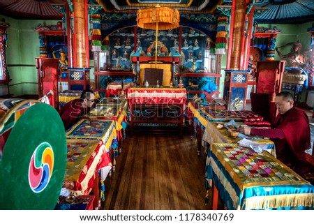 IVOLGINSKY DATSAN, ULAN UDE, SIBERIA, RUSSIA - MARCH 24, 2018: Buryat buddhist monks are praying to buddha at the Dzogchen Dugan in Ivolginsky datsan  #1178340769