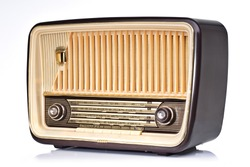 Ivory and brown vintage radio, perspective shoot showing the left side