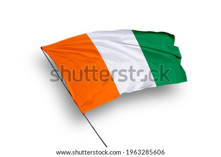 Ivory Coast flag isolated on white background with clipping path. close up waving flag of Ivory Coast. flag symbols of Ivory Coast.