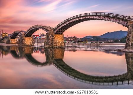 Iwakuni, Japan at Kintaikyo Bridge at dusk.
