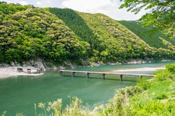 Iwama Chinkabashi at Shimanto River in Kochi Prefecture, Japan. Chinkabashi are low water crossings constructed without parapets in order not to be washed away by floods.