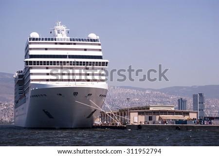 Izmir - Turkey, August 18,2015: big ship and small people in alsancak port.