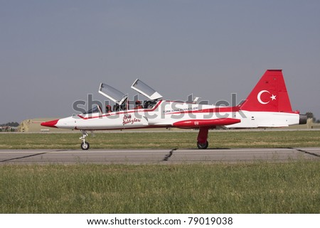 IZMIR,TURKEY – JUNE 06 :turkish demonstration team ´´ turkish stars´´  jet takes off at ´´Airshow Turkey´´ on june 06 2011 in izmir, Turkey, - stock photo