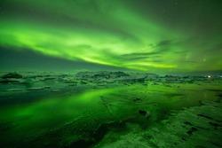 jökulsárlón lagoon under the aurora borealis or northen lights, Iceland
