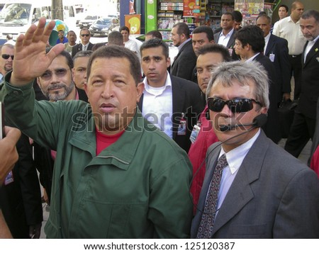 JABOATAO, BRAZIL - MARCH 26: Hugo Chavez talks to people on the street March 26, 2008 in Jaboatao, Pernambuco, Brazil. - stock photo