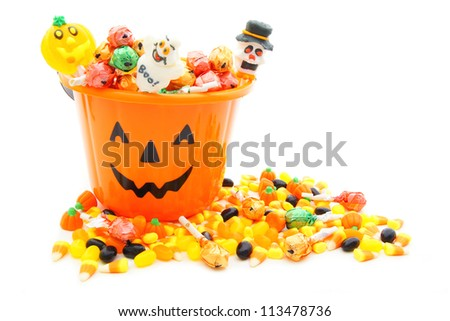 stock photo : Jack-o-lantern candy pail with a pile of colorful Halloween candy
