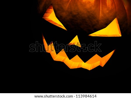 Jack O Lantern halloween pumpkin on black background. Close up with copy space. 3d render