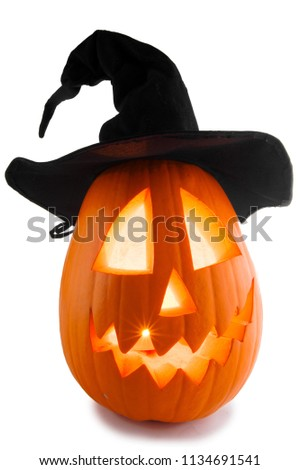 Jack O Lantern Halloween pumpkin with witches hat isolated on white background #1134691541