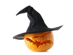 Jack-o-lantern pumpkin with witch hat on white background