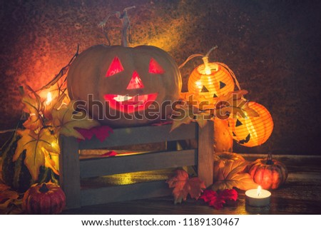 Jack O' Lanterns glowing on the old rustic background #1189130467