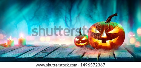 Jack O' Lanterns In Spooky Forest With Ghost Lights - Halloween Background