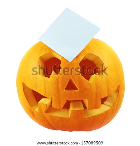 Jack-o'-lanterns pumpkin with a copyspace paper sticker over it isolated over white background