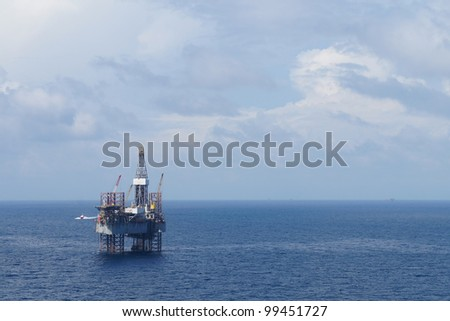 Jack up drilling rig in the middle of the coean