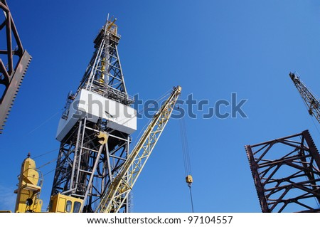 Jack up drilling rig with the rigcrane - Petroleum Exploration Industry