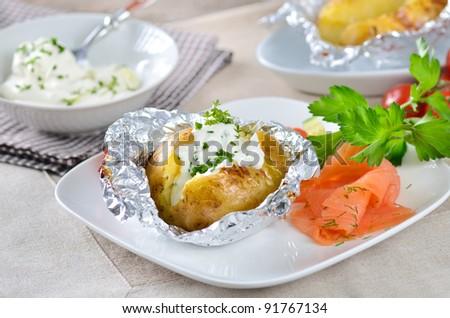Jacket potato with sour cream and smoked salmon