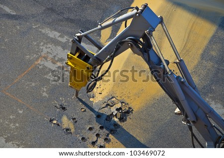 Jackhammer - pneumatic drill breaking street asphalt,Jackhammer - pneumatic drill breaking street asphalt, repairing damaged water supply