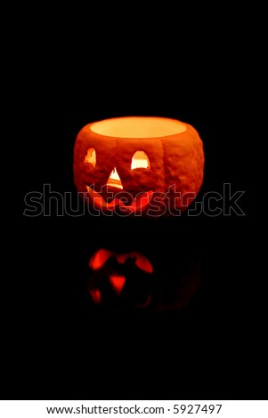 Jackolantern candle isolated on black background