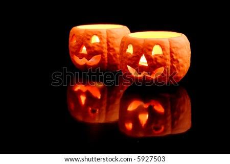 Jackolantern candles isolated on black background