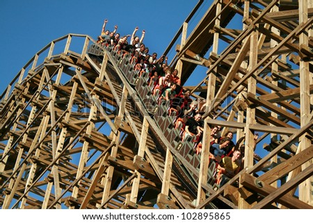 JACKSON, NEW JERSEY - MAY 5: People ride the El Toro which is the biggest wooden roller coasters in the world located at Six Flags Great Adventure in Jackson, NJ, USA on May 5, 2012.