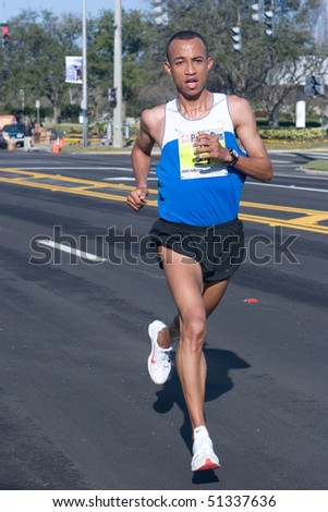 JACKSONVILLE, FLORIDA - MARCH 13: Mo Trafeh, age 24, of Duarte, CA wins 1st place in the 33rd Annual 15 Kilometer Gate River Run with a time of 42:58 on March 13, 2010 in Jacksonville, Florida.