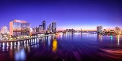 Jacksonville, Florida, USA city skyline panorama on St. Johns River at dawn.