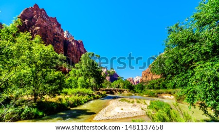 Jacob Peak on the left, one of the three peaks in the Court of the Patriarchs, and the Virgin River in Zion National Park in Utah, United Sates