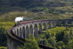Jacobite steam train on Glenfinnan Viaduct approaching, Highlands, Scotland, United Kingdom
