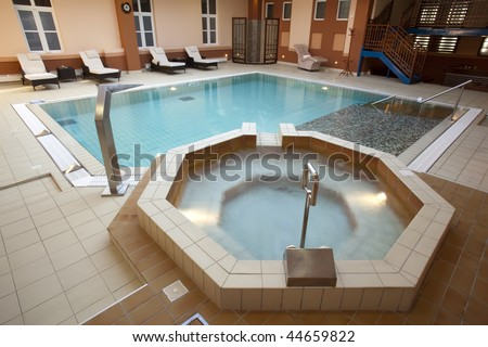 Jacuzzi bath near the swimming pool stock photo 44659822 shutterstock for Swimming pool and jacuzzi near me