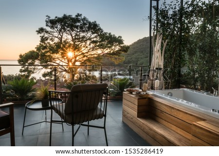 Jacuzzi on the balcony. Background of the sunset over the sea. Spa complex, boutique hotel  Photo stock ©