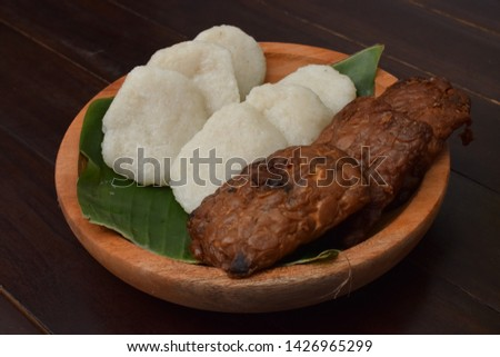 Jadah Tempe. Javanese traditional snack of savoury glutinous rice cake and fried Tempe Bacem.