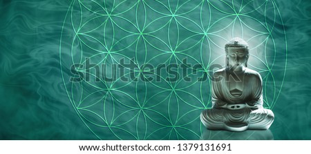 Jade Buddha meditating on the Flower of Life - Lotus position buddha on right with a jade hue against a wide jade gaseous  background and the Flower of Life symbol