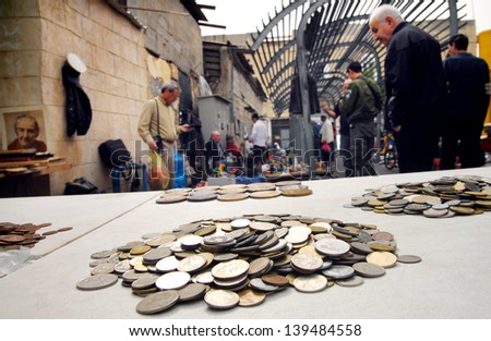 JAFFA,ISR - MAR 09:Old coins at the Flea Market in Jaffa on Mar 09 2008.It\'s an open air market throughout the year,a magnet for visitors, tourists and lovers of bargains and second hand items