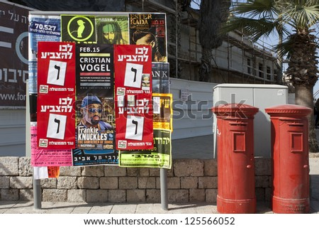 "JAFFA, JANUARY 22: The elections to Knesset 2013. Electoral campaign posters of the Arab socialist party Hadash with inscription: ""Against the current government. Hadash""; January 22, 2013 in Jaffa"