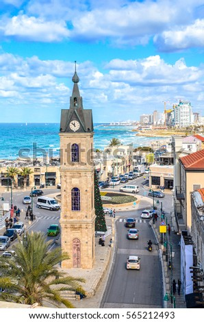 Jaffa old city clock tower. Tel Aviv in the background.