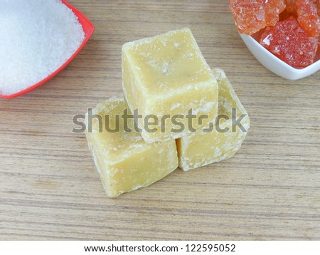 Jaggery cubes, which are unrefined sugar made from sugarcane.