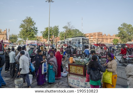 Jaipur, India - February 27, 2014 - Local people buying snacks at local market during daytime